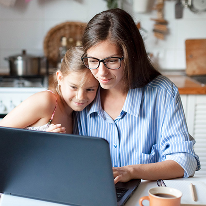 Mother and daughter using computer.